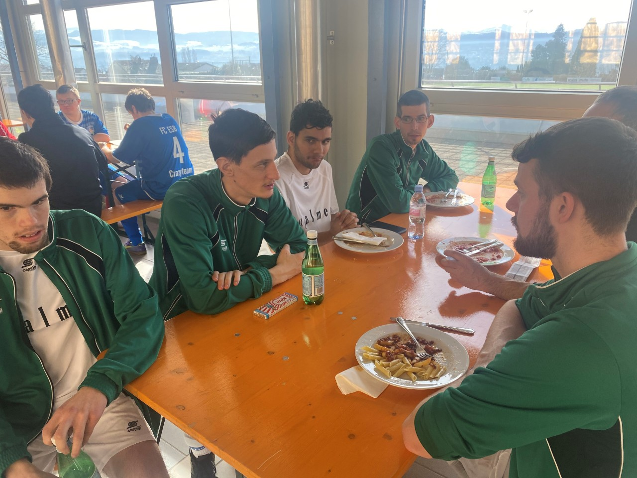 FC Palme players discussing their idols over lunch